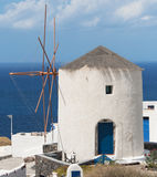 Windmill in Oia Stock Images