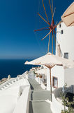 Windmill in Oia Santorini. Windmill in village center of Oia, Santorini, Greece Royalty Free Stock Photo