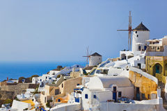 Windmill in Oia at Santorini, Greece. Vacation background Stock Images