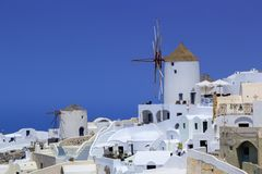 Windmill in Oia, Santorini, Greece. Old windmill in Oia by beautiful day, Santorini, Greece Stock Photos