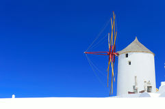 Windmill in Oia, Santorini, Greece. Typical cycladic windmill in Oia on Santorini island, Greece Royalty Free Stock Photos