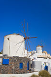 Windmill in Oia at Santorini, Greece. Vacation background Stock Image