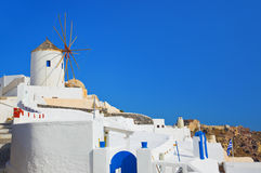 Windmill in Oia at Santorini, Greece. Vacation background Stock Photo
