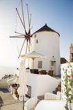 Windmill in Oia, Santorini, Greece. Windmill in Oia, Santorini. Oia is a village in the north west edge of the Santorini island with white houses, narrow streets Royalty Free Stock Image
