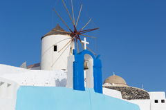 Windmill in Oia, Santorini, Greece. Windmill in Oia, Santorini. Oia is a village in the north west edge of the Santorini island with white houses, narrow streets Royalty Free Stock Photos