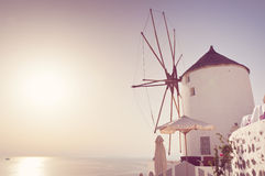 Windmill in Oia, Santorini, Greece. Windmill in Oia, Santorini. Oia is a village in the north west edge of the Santorini island with white houses, narrow streets Stock Photo