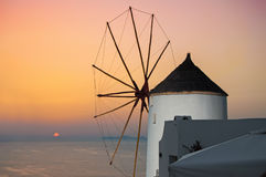 Windmill in Oia, Santorini, Greece. Oia is a village in the north west edge of the Santorini island with white houses, narrow streets and amazing seaviews Royalty Free Stock Image