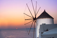 Windmill in Oia, Santorini, Greece. Oia is a village in the north west edge of the Santorini island with white houses, narrow streets and amazing seaviews Stock Image