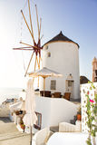 Windmill in Oia, Santorini, Greece. Oia is a village in the north west edge of the Santorini island with white houses, narrow streets and amazing seaviews Stock Photo