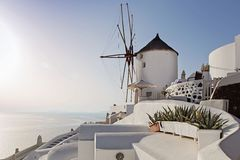 Windmill in Oia, Santorini island Stock Photo
