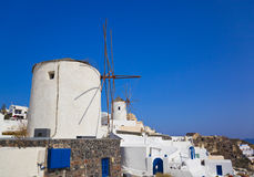 Windmill in Oia at Santorini island, Greece. Vacation background Royalty Free Stock Images