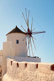 Windmill in Oia, Santorini. Shot at sunrise. Vertical shot Royalty Free Stock Photos