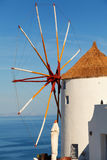 Windmill in Oia, Santorini. Shot at sunrise. Vertical shot. The sea on background Stock Image