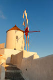 Windmill in Oia, Santorini. During a sunny summer day Royalty Free Stock Images