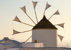 Windmill in Oia, Santorini. During a sunny summer day Stock Photo