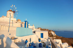 Windmill in Oia, Santorini. During a sunny summer day Stock Photos