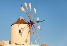 Windmill in Oia, Santorini. During a sunny summer day. Close up, horizontal shot Stock Photos
