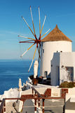 Windmill in Oia , Santorini. Windmill in Oia town, Santorini, Greece. Vertical shot Royalty Free Stock Photo