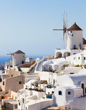 Windmill in Oia, Santorini. Oia is a village in the north west edge of the Santorini island with white houses Stock Image