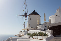 Windmill of Oia town at sunny day, Santorini Royalty Free Stock Image