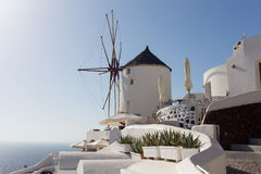 Windmill of Oia town at sunny day, Santorini Stock Image
