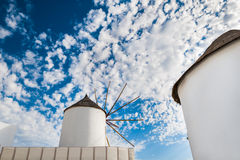 Windmill in Oia town. Stock Photos