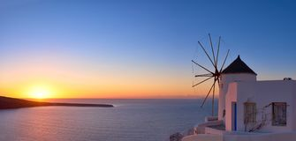 Windmill in Oia village on Santorini, Greece, at sunset. Windmill in Oia village on Santorin islandi, Greece, at sunset royalty free stock photography