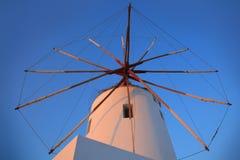 Santorini windmill with the bleu sky stock photos