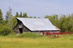 Windmill, old barn, and a cattle chute Stock Photos