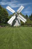 Windmill on old Cape Cod. Old windmill with green lawn frontage located on old Cape Cod in Massachussetts, USA royalty free stock images