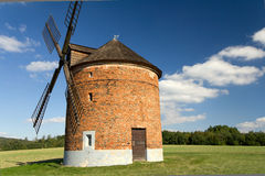 Windmill. Old windmill on the green hill in a sunny day Royalty Free Stock Images