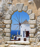 Windmill through an old Venetian window Royalty Free Stock Images