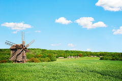 Windmill and old village Royalty Free Stock Photo