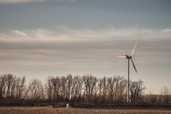 Windmill. With over cast sky in farm royalty free stock photo