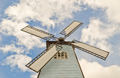 Windmill over cloudy sky Royalty Free Stock Images