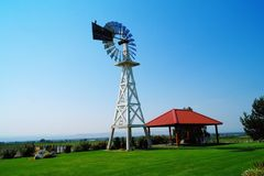Windmill overlooking a vineyard Royalty Free Stock Photo