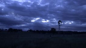 Windmill in a paddock stock footage
