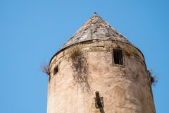 Windmill in Palma de Mallorca, Spain. Old windmill in Palma de Mallorca, Spain, with blue sky as background Royalty Free Stock Photo