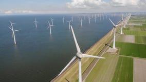 Windmill park westermeerdijk Netherlands, wind mill turbine with blue sky in ocean, green energy. Global warming concept stock video footage