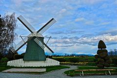 Windmill in park. Windmill, bench and tree near Mount Vernon. Washington. United States Royalty Free Stock Photo