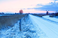 Windmill and path for bikes in winter Holland Stock Image