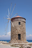 Windmill on the pier in Rhodes, Greece Stock Photography