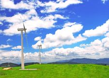 Windmill on  a plain  under blue Stock Photo