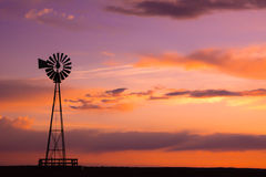 Windmill on the Plains. A picture of a windmill at sunset near the Pawnee Buttes national grasslands Royalty Free Stock Image