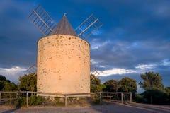 Windmill at Porquerolles island. Evening beautiful light. stock photography