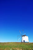 Windmill at portuguese field Stock Photo