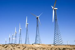 Windmill power 2. Wind turbine windmills on a hill generating electricity Royalty Free Stock Photography