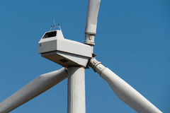Windmill power generator against sky. Close up Royalty Free Stock Photo