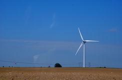 Windmill and power-line. Electricity by windmill and power-line royalty free stock photo