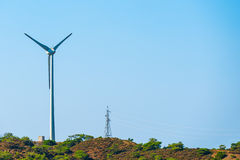Windmill and power line Royalty Free Stock Photography